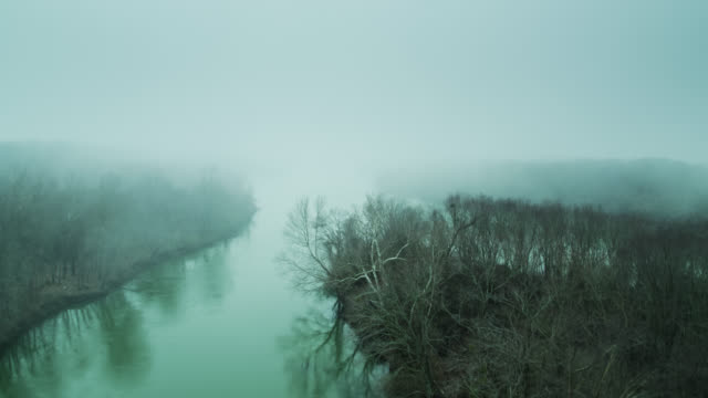 confluence of illinois and arkansas rivers in winter fog - drone shot - midwest usa stock videos & royalty-free footage