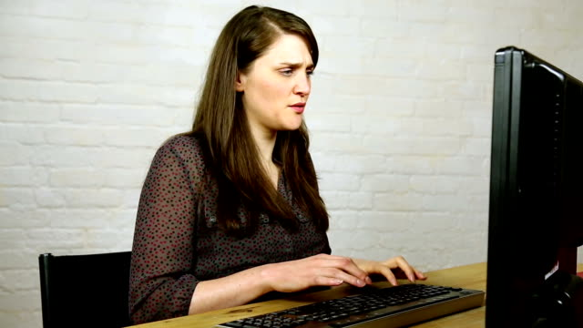confused and upset young woman discovers cheating husband on computer