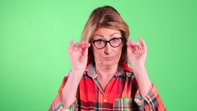 confused senior woman - plaid shirt stock videos & royalty-free footage