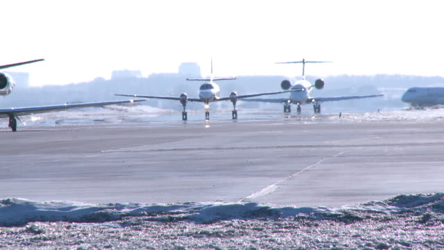 conga line of three airplanes in winter - close shot - taxiing stock videos & royalty-free footage