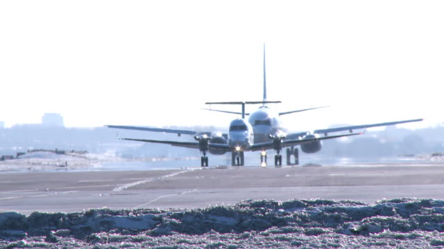 conga line, two airplanes in winter - wideshot - taxiing stock videos & royalty-free footage