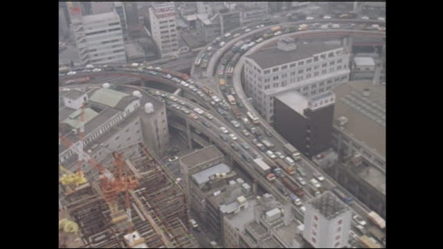congested traffic moves slowly through the edobashi junction of the metropolitan expressway inner circular route in chuo, tokyo. - showa period stock videos & royalty-free footage