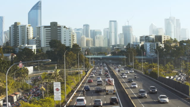 congested traffic with city skyline - queensland stock videos & royalty-free footage
