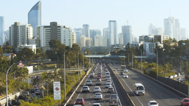 Congested traffic with city skyline