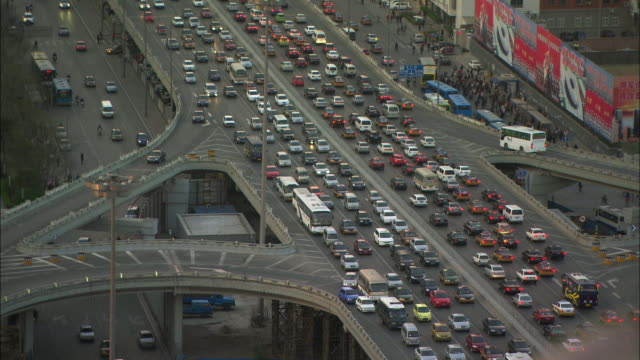ws ha tu congested traffic with skyline, beijing, china - beijing stock videos & royalty-free footage