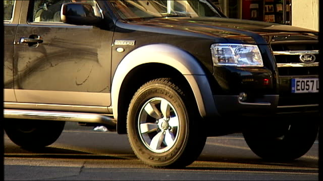 """congestion charge rise for """"gas guzzlers"""" in london; ext various shots of people carriers and 4x4 vehicles in central london, including a land rover,... - land rover stock videos & royalty-free footage"""