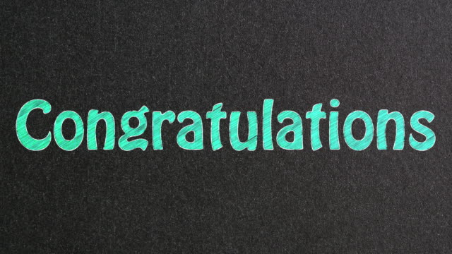 congratulations text on blackboard - congratulating stock videos and b-roll footage