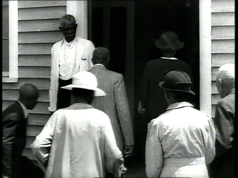 1939 ms congregation entering church past usher - racism stock videos & royalty-free footage