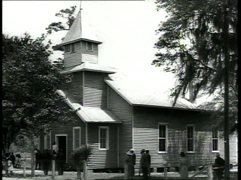 1939 cu congregation entering old-fashioned wooden church / usa - segregation stock videos & royalty-free footage