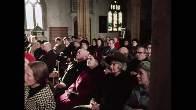 a congregation in a church service, uk, 1970s - christianity stock videos & royalty-free footage