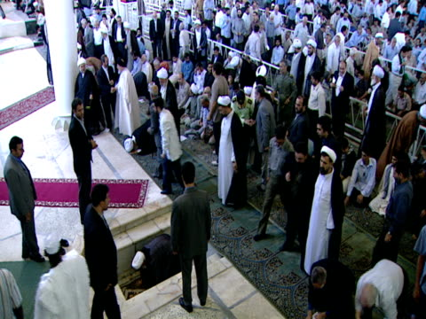 ha congregation of worshipers exiting following closing of midday prayer service / qom iran - midday stock videos and b-roll footage