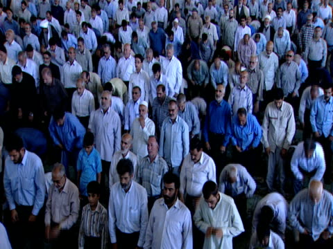 ha congregation of worshipers kneeling and bowing during midday prayer / qom iran - midday stock videos & royalty-free footage