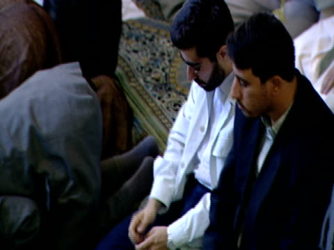 tu congregation of worshipers kneeling while observing midday prayer / qom iran - midday stock videos & royalty-free footage