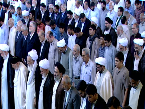 ha congregation of worshipers standing while observing midday prayer / qom iran - midday stock videos & royalty-free footage