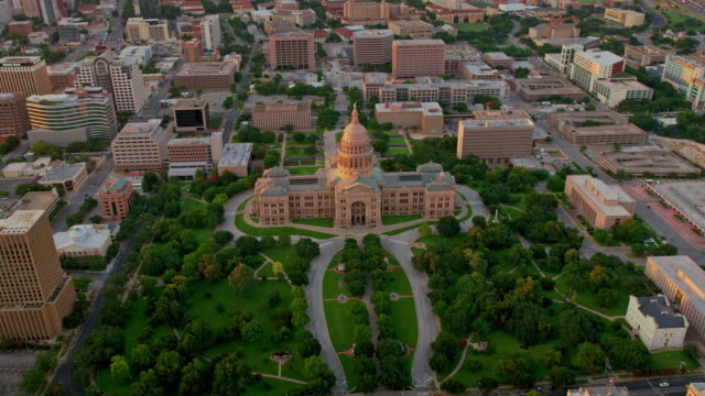 aerial congress avenue and texas state capitol in austin, tx, at sunset - austin texas video stock e b–roll