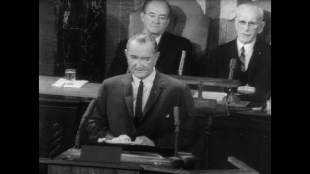 Congress gives standing ovation to President Lyndon B Johnson as he takes to the center podium to give State of Union Address / the president states...