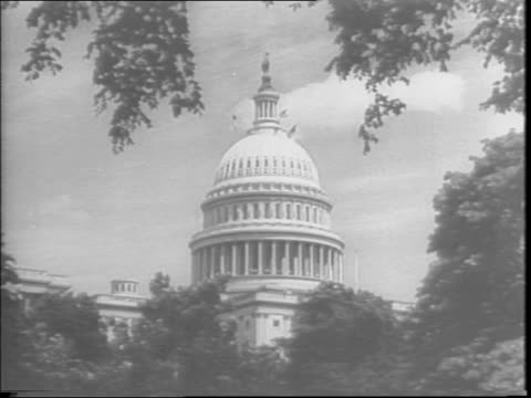 vídeos de stock, filmes e b-roll de congress overrides the president's veto antistrike bill and passes the war labor disputes act the smithconnally antistrike act / capitol building in... - paramount building
