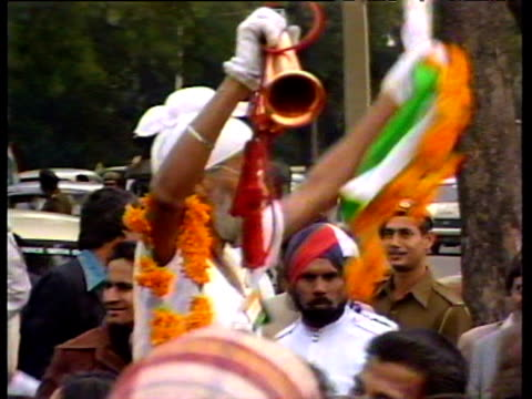 congress party supporters celebrate rajiv gandhi's election as prime minister on streets india dec 84 - congress party stock videos and b-roll footage