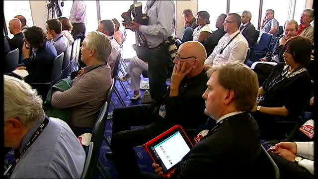 unions vote for co-ordinated strike action; england: dorset: bournemouth: int delegates at tuc conference delegate reading newspaper ext tuc... - newspaper strike stock videos & royalty-free footage