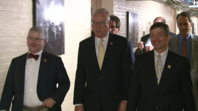 stockvideo's en b-roll-footage met congressman jeb hensarling and others walk down a hallway - united states and (politics or government)