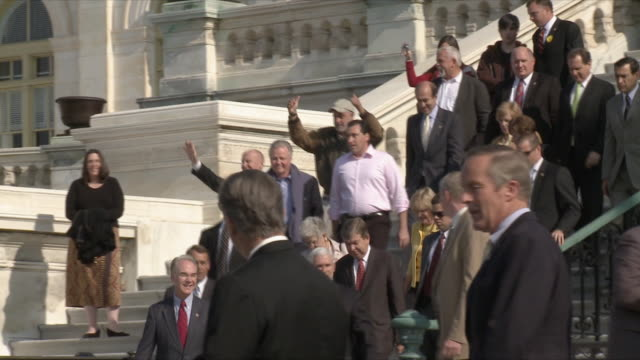 congressman tom price with other politicians walking down capitol building steps during political rally against health care legislation on november... - 下院議員点の映像素材/bロール