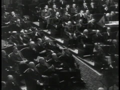 vídeos de stock, filmes e b-roll de congressmen seated in session. - 1935