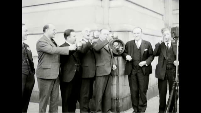 congressmen toast and cheer repeal of prohibition and raise a mug of beer - 禁酒法点の映像素材/bロール