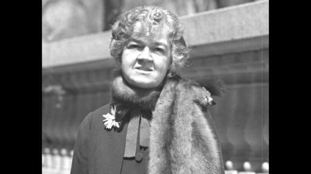 congresswoman edith nourse rogers wearing a fur stole stands outdoors behind table with japanese manufactured items us capitol dome stands in... - made in the usa kort fras bildbanksvideor och videomaterial från bakom kulisserna