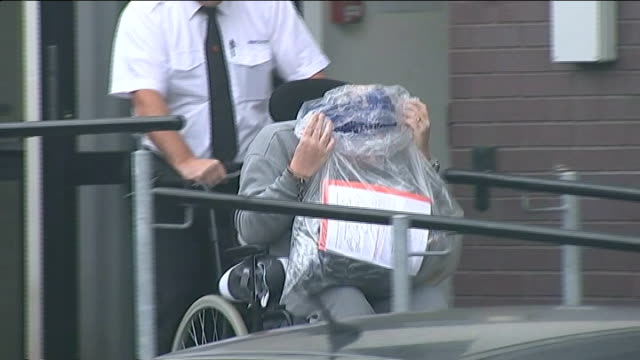 conman accused of faking coma to avoid trial jailed ext alan knight being wheeled out of court knight being wheeled along to van van driving away - 脱獄する点の映像素材/bロール