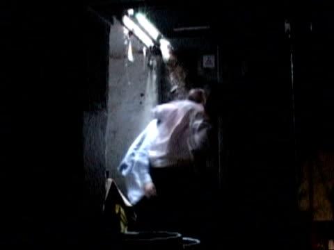 stockvideo's en b-roll-footage met conman jailed for life tx reconstruction of freegard beating and punching blindfolded john atkinson in pub cellar - bewegingsbeperkende middelen