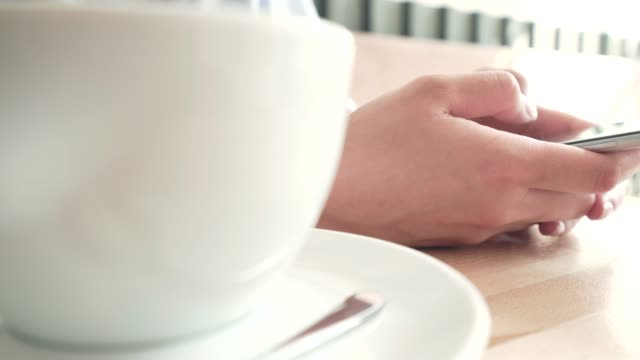 connected with my smart phone at coffee shop. - wasting time stock videos & royalty-free footage