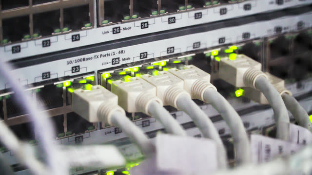 connecting cable and the led lights blinks. the internet server and server of local network - computer part stock videos and b-roll footage