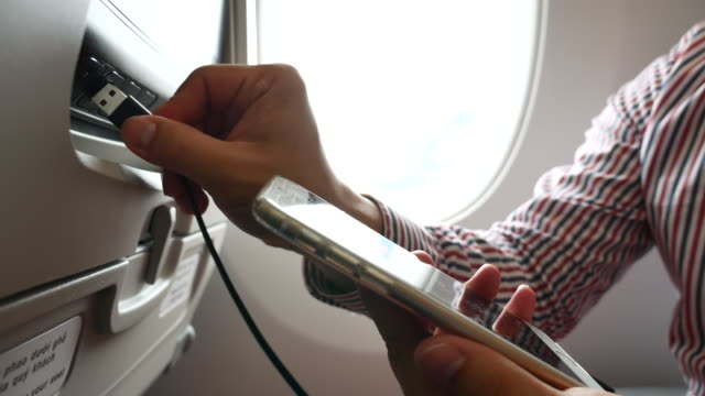 Connection of cell phone into seat monitor in airplane via, Business Travel