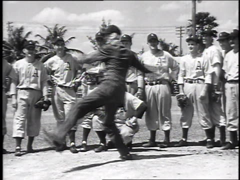 connie mack on mound winds up and throws / connie mack demonstrating grip on ball / connie mack shows wind up younger players watching - spring training stock videos & royalty-free footage