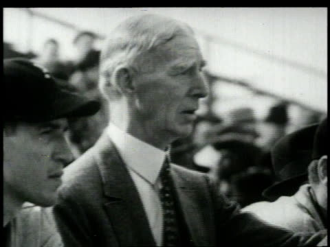 vídeos de stock e filmes b-roll de connie mack sitting in stands / united states - 1949