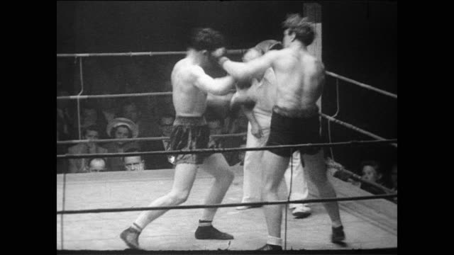 vídeos y material grabado en eventos de stock de / conny rux and giorgio milan fight in ring while crowd watches and cheers / milan gets knocked down / rux knocks out milan for the win boxing match... - 1951