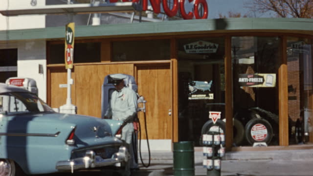 1956 montage conoco gas station, gas attendant / usa - gas station attendant stock videos and b-roll footage