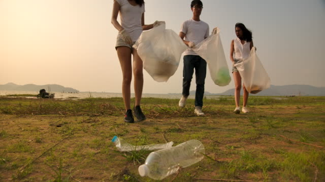 conservation groups are collecting garbage - altruism stock videos & royalty-free footage