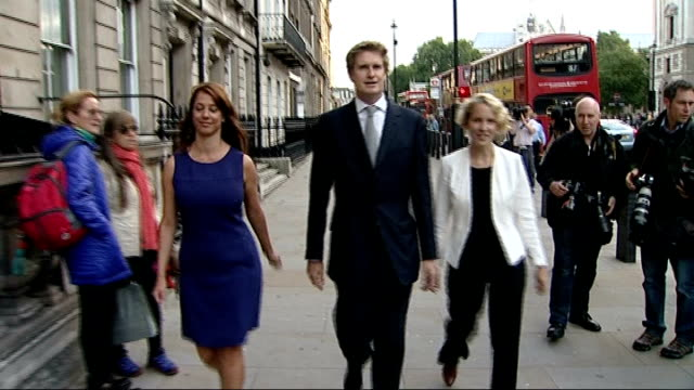 conservative and labour party reshuffles; new shadow cabinet members, gloria de piero mp , tristram hunt mp and emma reynolds mp along road together... - gloria de piero stock videos & royalty-free footage