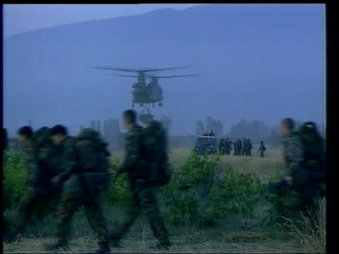 Conservative attack KOSOVO British soldiers along with helicopter in b/g