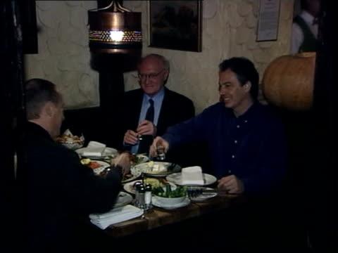 conservative attack; russia: moscow: int blair sitting at table in bar with russian president vladimir putin as drinking vodka: tgv blair & putin... - ウォッカ点の映像素材/bロール