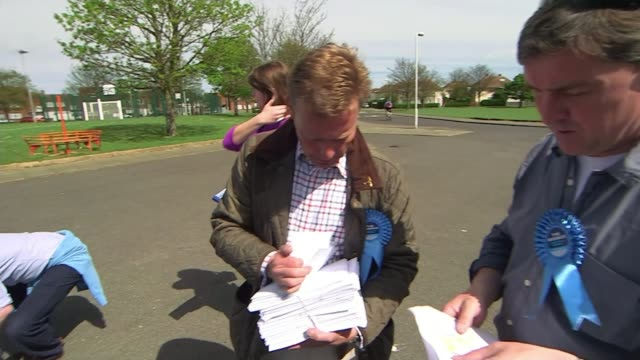 stockvideo's en b-roll-footage met conservative candidate craig mackinlay charged over 2015 general election expenses t04051522 / tx ramsgate ext craig mackinlay with election leaflets... - ramsgate