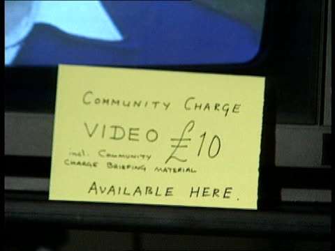 stockvideo's en b-roll-footage met 4443 community charge video on display in exhibition area people looking at books and paraphernalia book by norman tebbit 'upwardly mobile' on... - geoffrey howe
