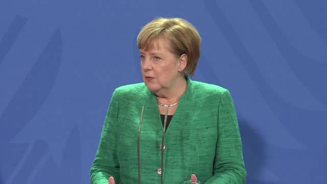Conservative Chancellor Angela Merkel calls on the Social Democrat party to approve the coalition with her CDU party so that Germany can have a...