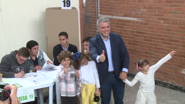 Conservative front runner Ivan Duque casts his vote in Colombia's first round of presidential elections and vowing to fight corruption head on