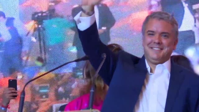 Conservative Ivan Duque celebrates winning Colombia's presidential election after a campaign that turned into a referendum on a landmark 2016 peace...