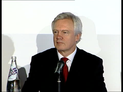 David Davis speech on social justice ENGLAND David Davis MP sitting at microphone as putting sweet in his mouth
