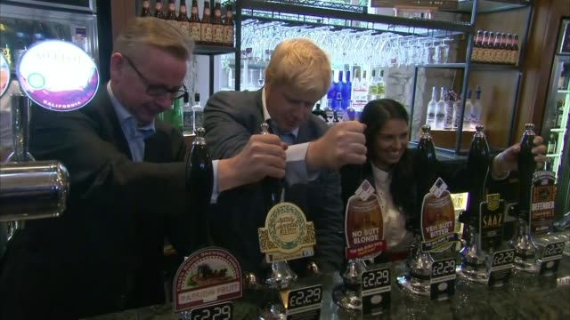 michael gove eliminated lib / lancashire darwen int michael gove mp boris johnson mp and priti patel mp pouring pints in wetherspoons pub 'no butt... - elimination round stock videos and b-roll footage