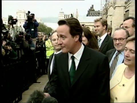 Second round of voting ENGLAND London Houses of Parliament St Stephen's entrance EXT David Cameron MP towards to pose for press following second...