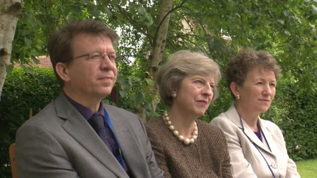 view of conservative members and supporters england oxfordshire ext theresa may mp opening venison house project at john watson school by ringing... - school bell stock videos and b-roll footage